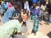 grandmother-and-child-receiving-food-at-iris-africas-feeding-program