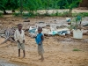boys-with-the-salvaged-materials-from-their-collapsed-home