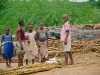 children-beside-their-fallen-house-rice-packages-given-by-iris-africa