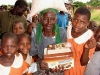grandmother-carries-food-home-to-her-orphans-resized