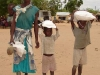crippled-widow-and-her-children-carry-home-the-gift-of-maize