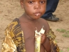 child-eats-sugar-cane